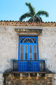 Old balcony with a palm tree in the background — Stock Photo