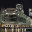 Canary Wharf skyscrapers in London at night - Stock Photo