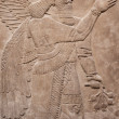 Ancient assyrian winged god - Stock Photo