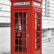 Red telephone booth in London, England - Stock Photo