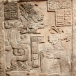 Old mexican relief carved in stone — Stock Photo