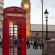 A  red phone in London and Big Ben - Stock Photo