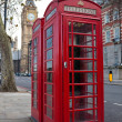 Stock Photo: Pair of typical red phone in London