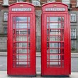 Stock Photo: A pair of typical red phone in London