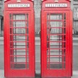Two typical London red phone cabins — Stock Photo