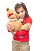 Small girl hugging a teddy bear — Stock Photo