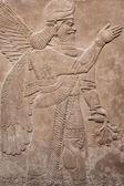Deus alado assírio antigo — Foto Stock