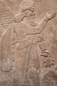 Ancient assyrian winged god — Stock Photo