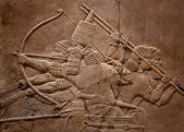 Ancient relief of assyrian fighting — Stock Photo