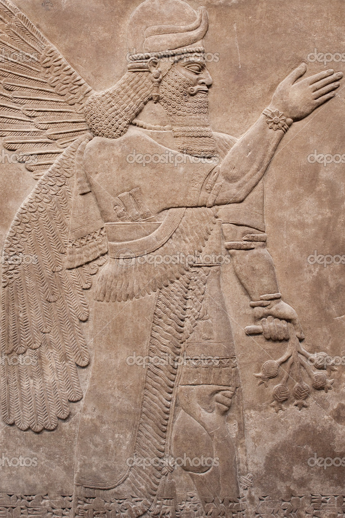 Ancient assyrian winged god carved in stone    Photo by kmiragayaAssyrian Gods