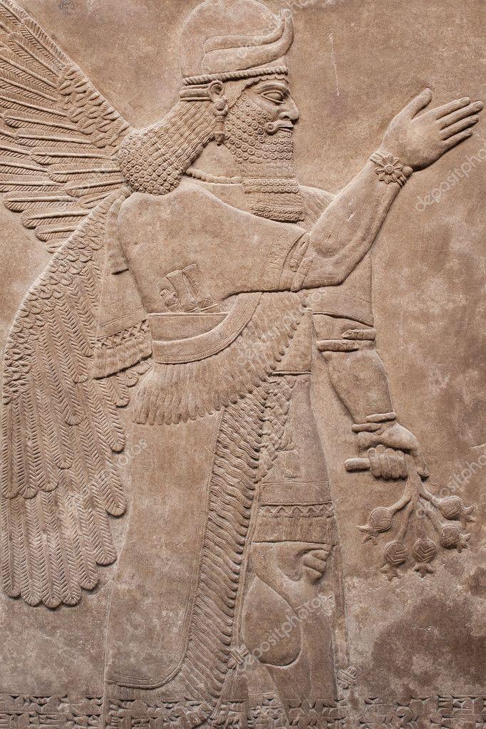 Ancient assyrian winged god — stock photo kmiragaya