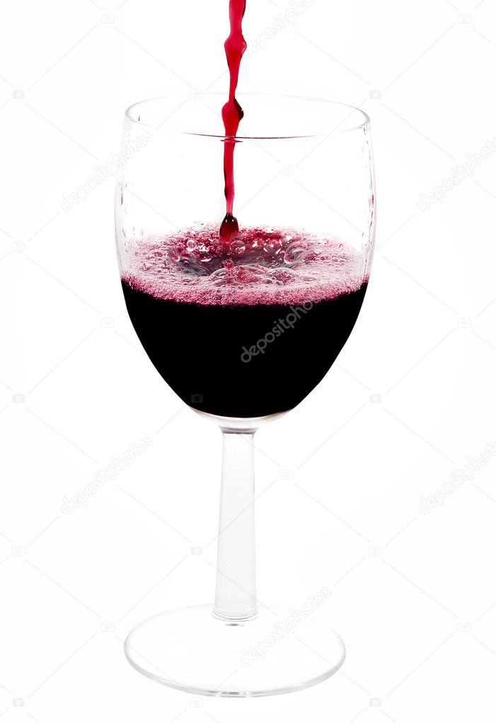 A clear glass with red wine pouring from the top of the picture — Stock Photo #2429888