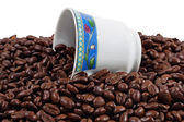 Cup and fresh roasted coffee beans — Stock Photo