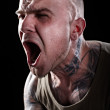 Angry tattooed man screaming — Stock Photo