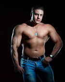 Handsome muscular young man — Stock Photo