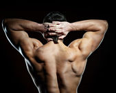 Back of muscular young man — Stock Photo