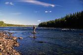 Fishing in river — Stock Photo
