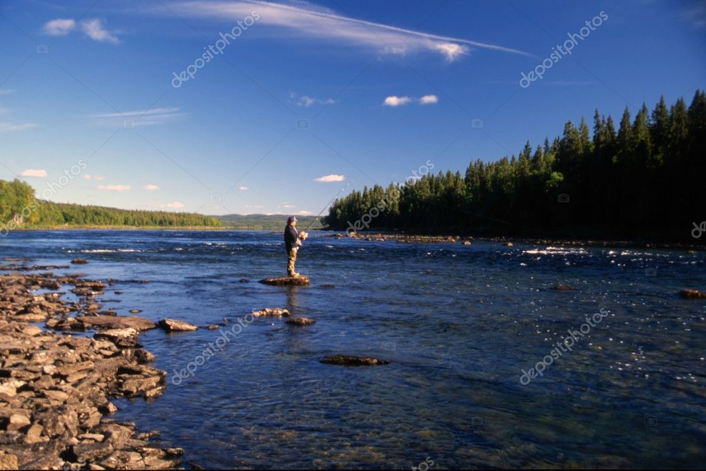 A man fishing in a river in sunny day — Stock Photo #2447333