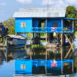 Typical House on the Tonle sap lake, between Sie - Stock Photo