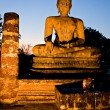 Buddha illuminated at night, Sukhothai, Thailand - Stock Photo