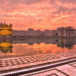Golden Temple at sunset,  Amritsar, Punjab, Ind - Stock Photo
