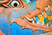 Close-up of a naga face in a buddhist temple, Lu — Foto Stock