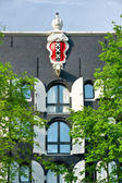 Emblem of Amsterdam in a palace, — Stock Photo