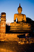 Buddha illuminated at night, Sukhothai, Thailand — Stockfoto
