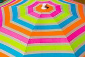 Colorful umbrella on the beach — Stock Photo