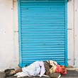 Sleeping on the street - Stock Photo