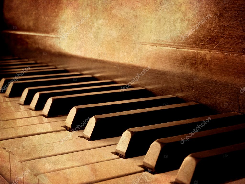 Closeup of black and white piano keys and wood grain with sepia tone — Stock Photo #2329829