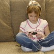 Little girl listening to mp3 - Stock Photo