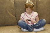 Little girl listening to mp3 — Stock Photo