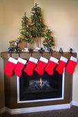 Christmas Stockings and Fireplace — Stock Photo