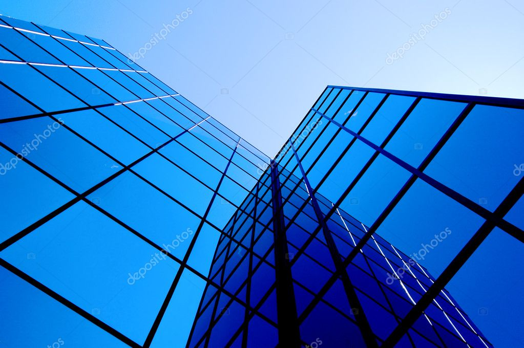 Office building details reflecting blue sky and clouds in windows — Stock Photo #2348590