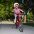 Little Girl Riding Fast on a Bike — Stock Photo
