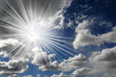 Clouds in Blue Sky with Sun — Stock Photo