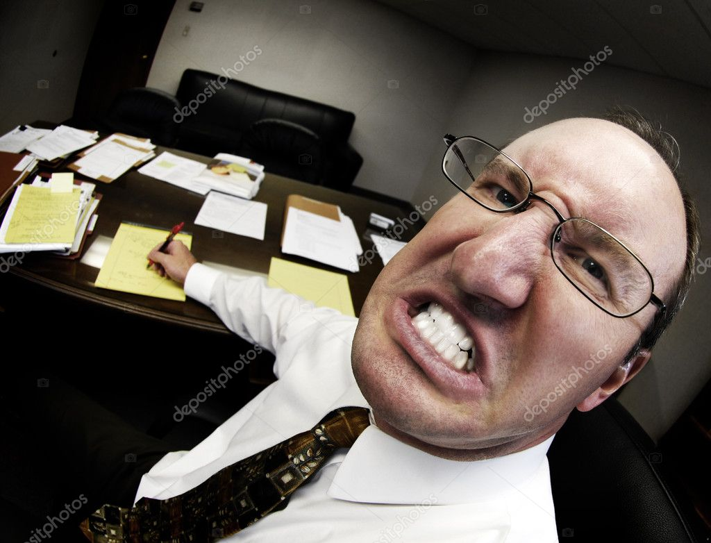 Mean looking man in business office gritting teeth — Stock Photo #2507203