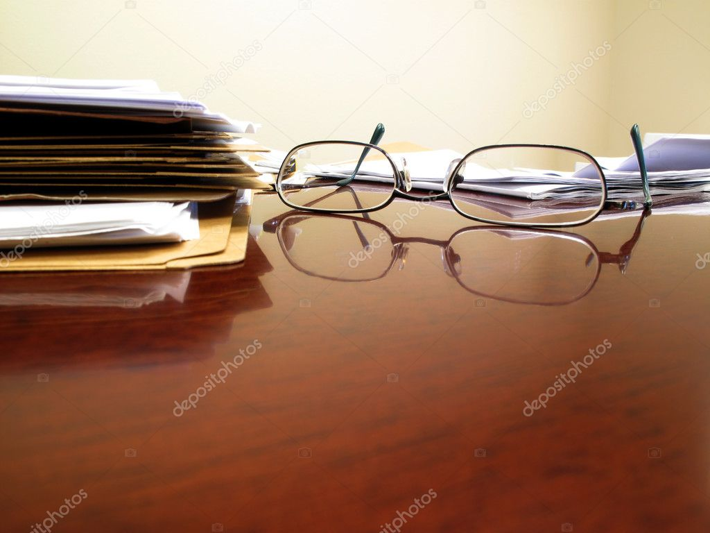 Desk with papers and glasses — Stock Photo #2507236