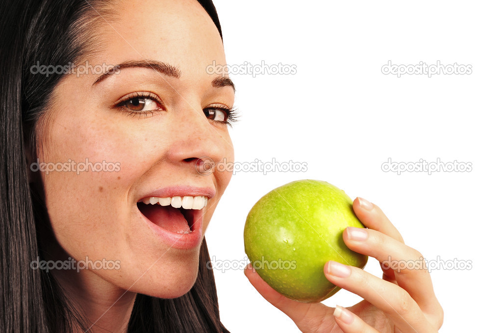 Attractive young brunette woman eating a green apple — Stock Photo #2455943