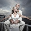 Newlywed couple posing by the water — Stock Photo #2288929