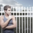 Man posing by a fence — Stock Photo