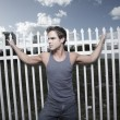 Man posing by a fence — Stock Photo #2330763
