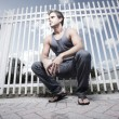 Man by a fence — Stock Photo