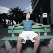 Man sitting on a bus bench — Stock Photo #2330860