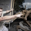 Man hanging from heavy machinery — Stock Photo