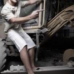 Man hanging from heavy machinery — Stock Photo