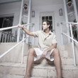 Handsome man sitting on stairs — Stock Photo