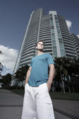 Man posing by a building — Stock Photo