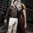 Stock Photo: Couple in the city at night